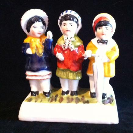 Porcelain Figurine Displaying Three Little Ladies