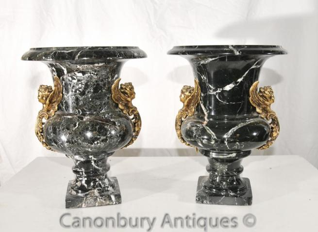 Pair French Empire Black Marble Campana Urns Cherub Handles